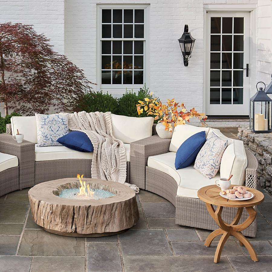 Bryndle Faux Wood Root Propane Fire Pit with Sectional on Patio