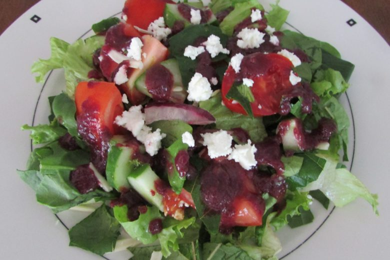 blue grape dressing on salad with goat cheese