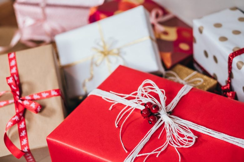 Christmas Gifts with Various Decorative Ribbons, Bows and Embellishments