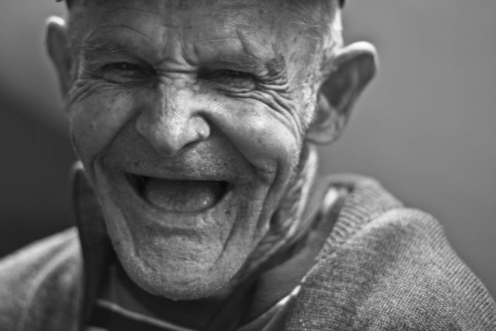 Happy smiling old man with wrinkled face