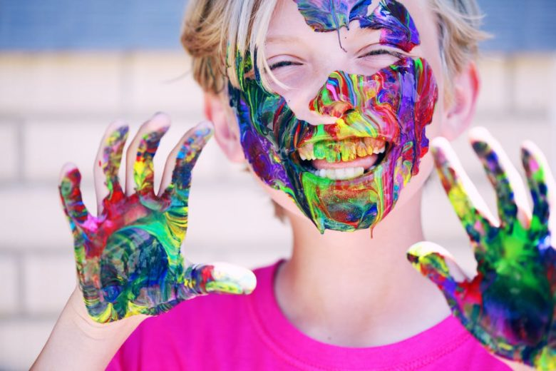 Smiling Happy Child with Paint on Face