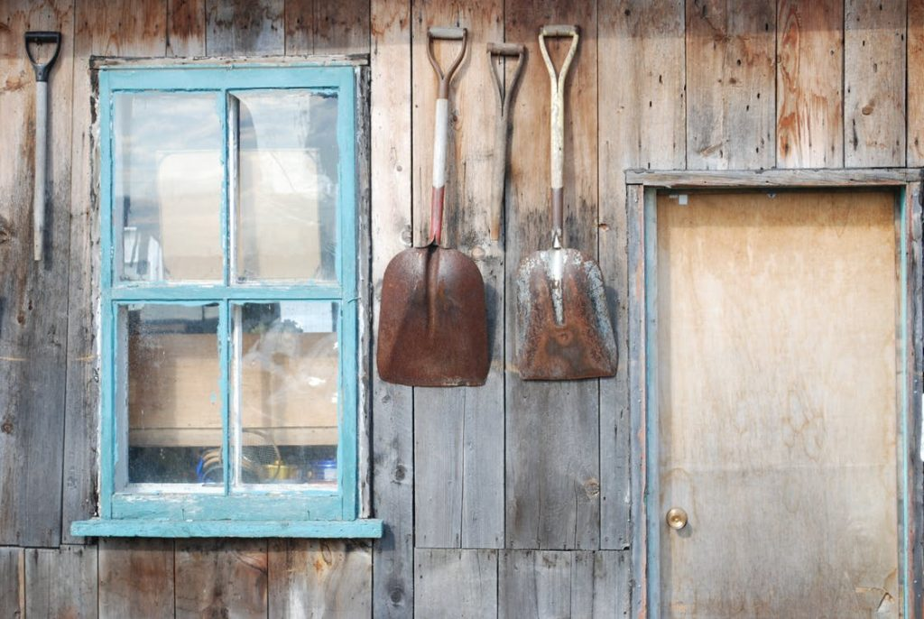 Garden Tools Hanging on Garage Wall