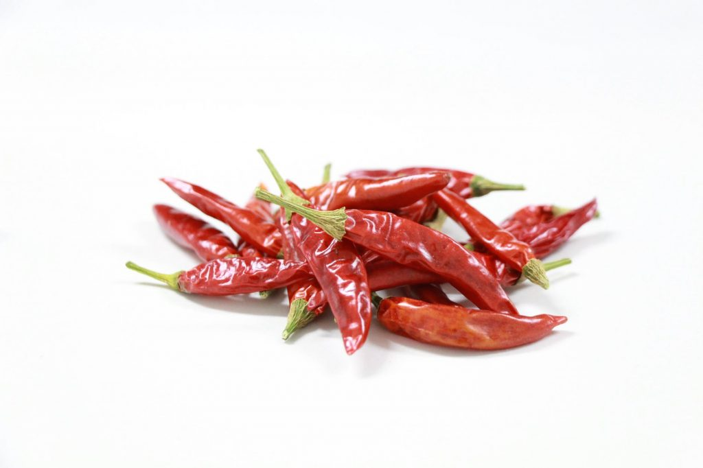 Dried chili peppers can be used to try to deter groundhogs.