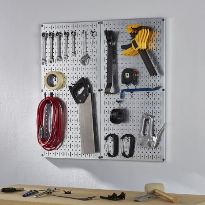 Metal modular pegboard with pegs for storing tools
