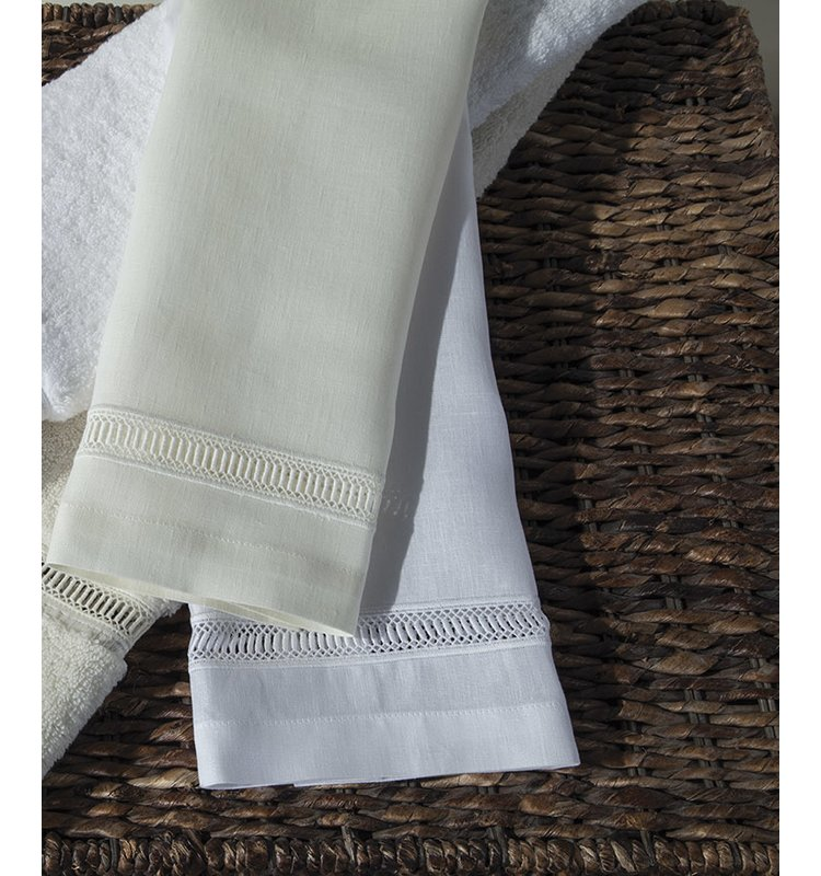 Natural linen table napkins in white and flax colors.