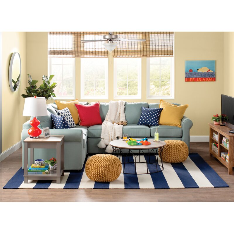 Large knit poufs in fun colorful living room.