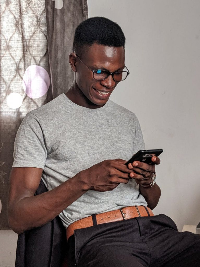 Happy person on smart phone