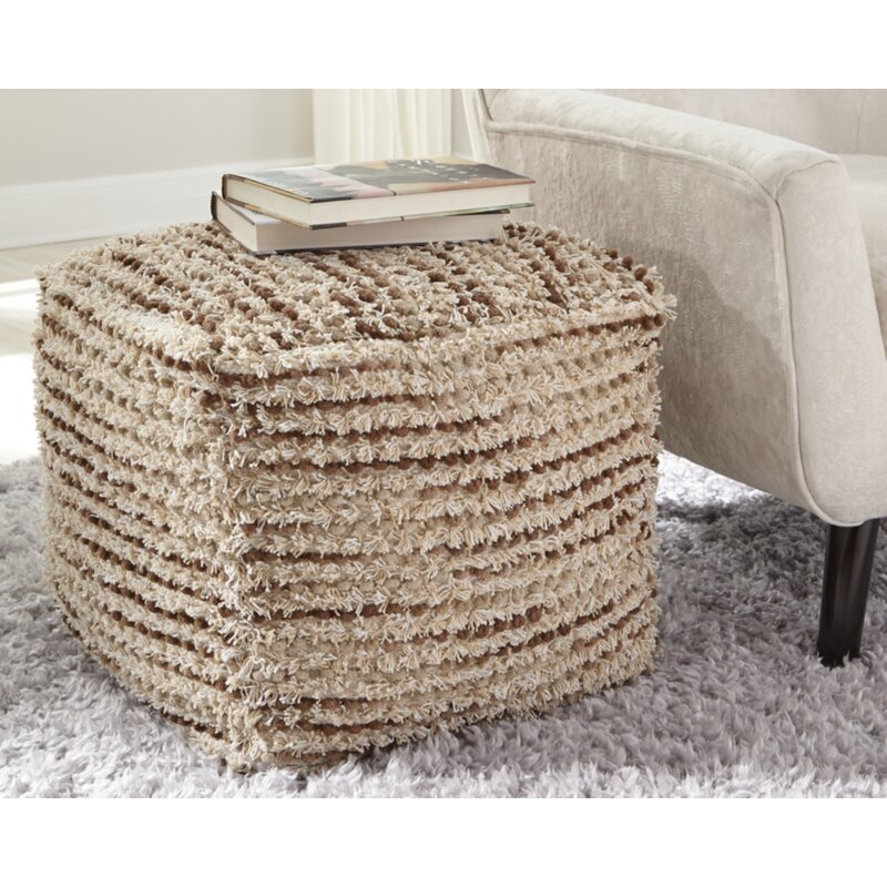 Pilcher Pouf Ottoman Used as a Side Table