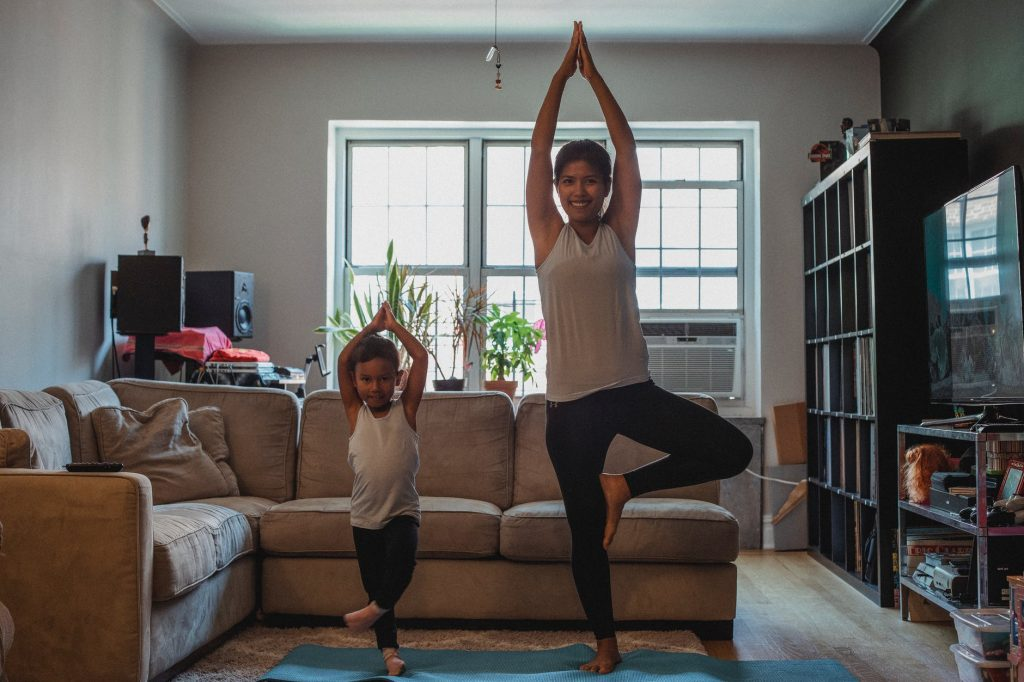 Mother and Daughter Doing Happy Yoga