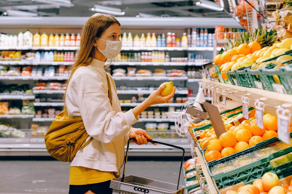 Girl Grocery Shopping wearing COVID-19 Face Mask