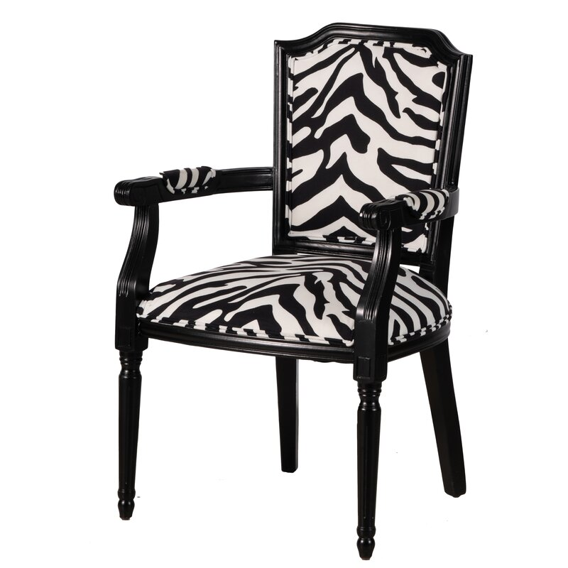 Classic styled upholstered zebra print dining chair with arms.