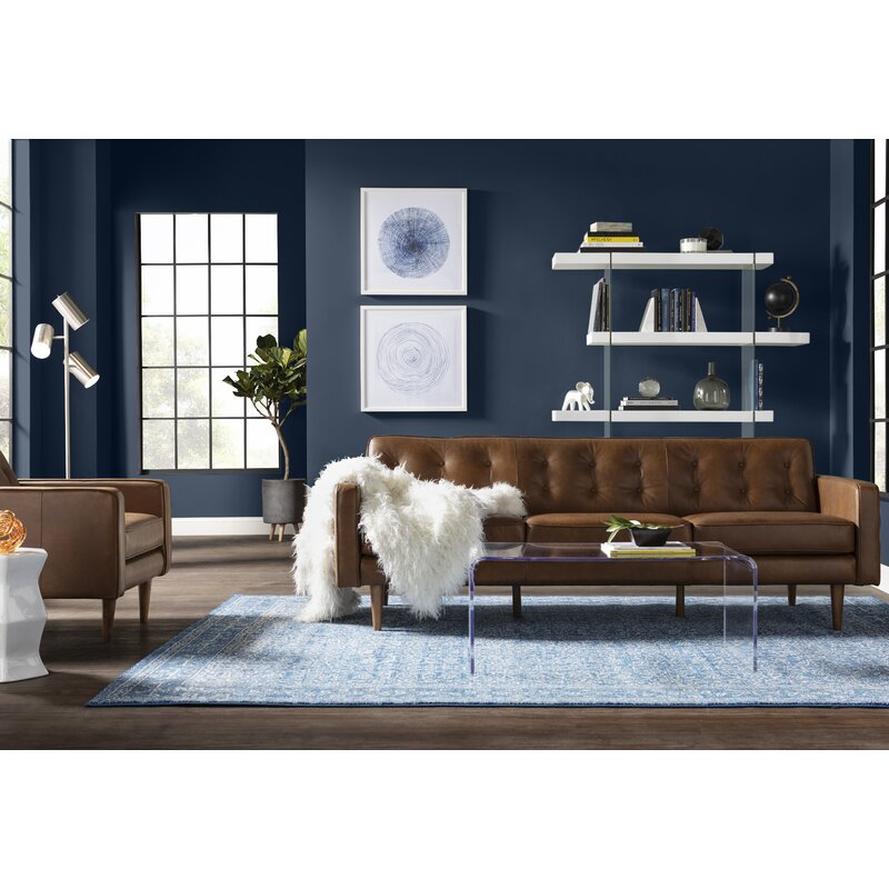 Mercury Row Clear Acrylic Coffee Table in Masculine Living Room