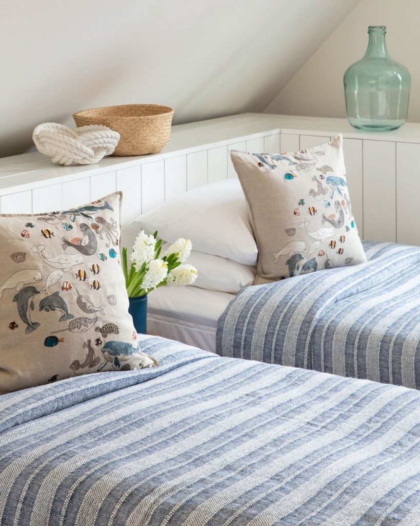 Coral and Tusk Linen Pillow with Sea Creatures in Bedroom