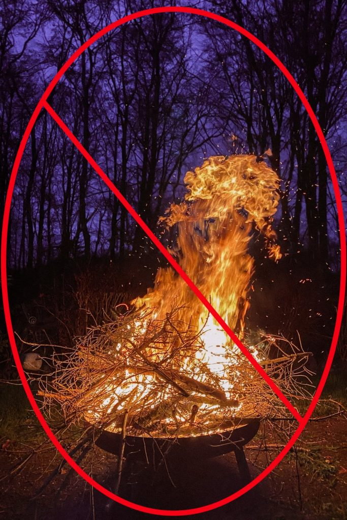 Fire in Fire Pit which is Dangerously Large with Do Not Do Red Circle
