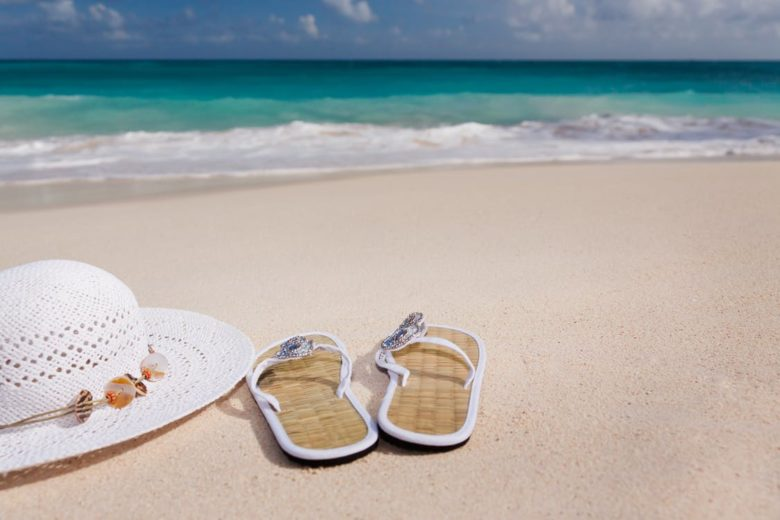 Hat and Flip Flops on Tropical Beach
